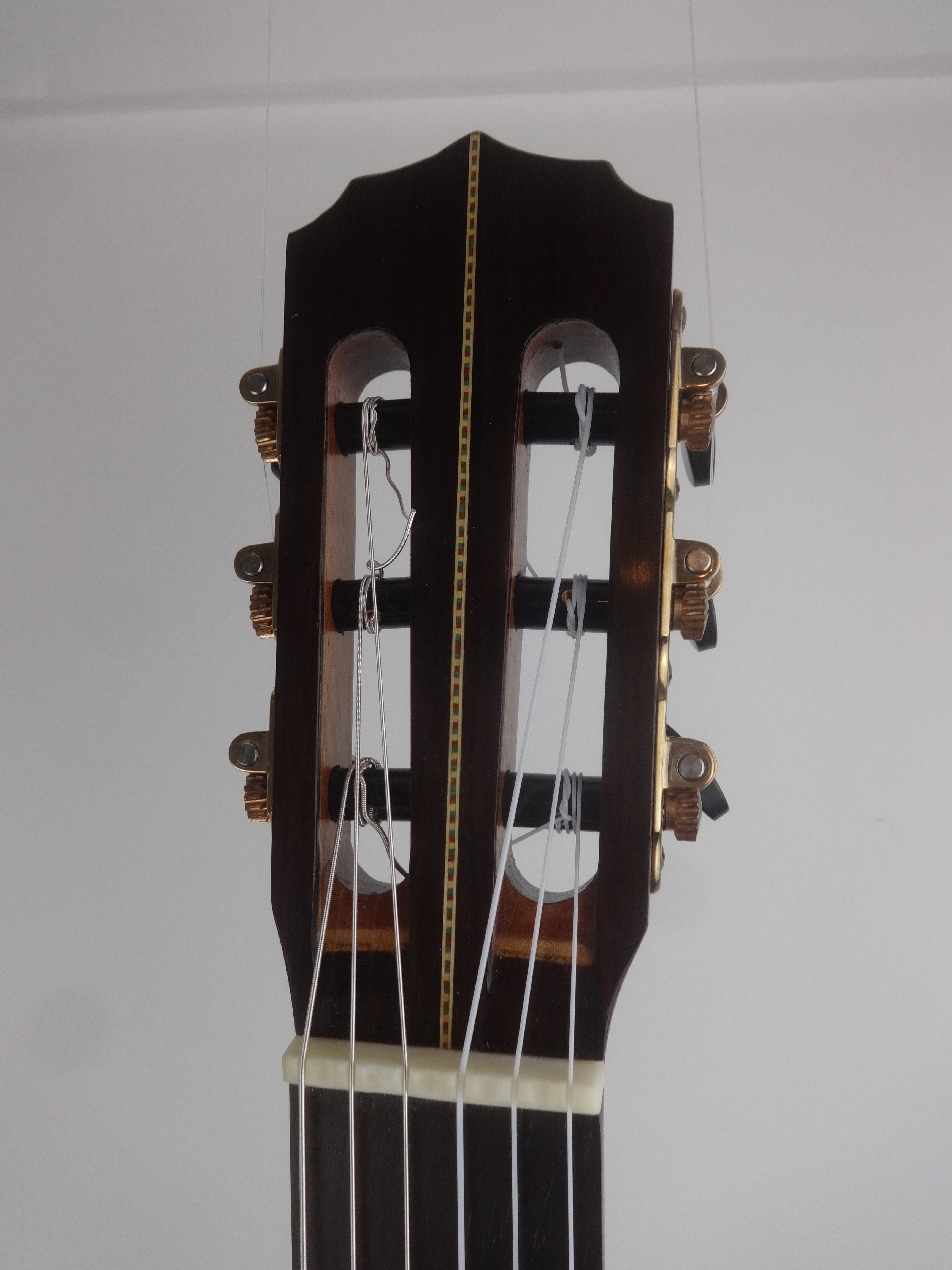 Headstock. Sloane tuning machines with low friction rollers.