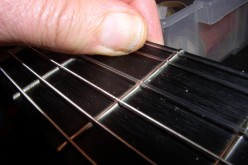 At the second fret B string. The G is worse.